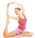 Shot of a sporty young woman doing yoga exercise isolated over white background Royalty Free Stock Photos