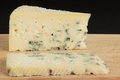 Shot two gorgonzola pieces wooden board Stock Photography