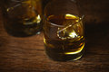 Shot of whiskey on old wooden surface background Royalty Free Stock Image