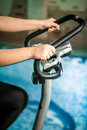 Shot woman riding exercise bike Royalty Free Stock Image