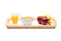 Shot of a wooden tray with apples, bananas, cereal and orange juice Stock Images