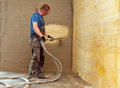 Shotcrete worker concrete cast in place or nozzleman at work Royalty Free Stock Images