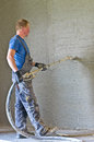 Shotcrete worker concrete cast in place or nozzleman at work Royalty Free Stock Photography