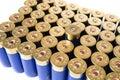 Shotgun ammo one fired shell among unused isolated on white Royalty Free Stock Photo