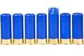Shotgun ammo one fired shell among unused isolated on white Stock Photos