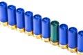 Shotgun ammo one green among blue Stock Photography