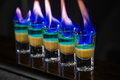 Shots in nightclub barman make alcoholic Stock Photography