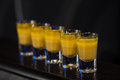 Shots in nightclub barman make alcoholic Royalty Free Stock Photos