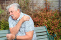 Shoulder pain or injury an elderly man holding his because of Stock Photography