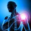 Shoulder pain of male in blue Royalty Free Stock Photography