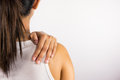 Shoulder pain woman holding her painful Stock Photos