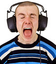 Shout male music lover with big headphones Royalty Free Stock Photos