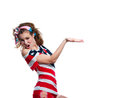 Shouting american girl beautiful young funny patriotic wearing colorful pink blue head band red shorts off the shoulder top tank Stock Image