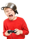 Shouting boy with gamepad in hands a pan on the head and the is isolated on a white background very emotional Stock Photo