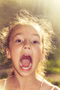 Shouting loud little girl at sunset Royalty Free Stock Photo