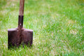 Shovel in green grass old metal Royalty Free Stock Photo