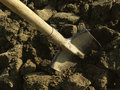 Shovel in the ground ploughed Royalty Free Stock Photography