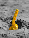 Shovel in the sandbox yellow sand on black and white background Stock Photo