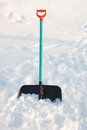 Shovel for snow cleaning sticks out Royalty Free Stock Photo