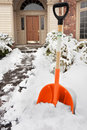 Shoveling path to the door Royalty Free Stock Photos