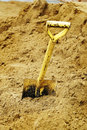 Shovels in sand Royalty Free Stock Photo