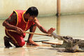 Show of crocodiles thailand samutprakan oct traditional for thailand crocodilesthe trainer put the log into the jaws a crocodile Stock Images