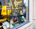 Showcase antique shop on the streets of one of the european Royalty Free Stock Images