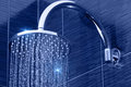 Shower closeup of chrome head with flowing water Royalty Free Stock Photo