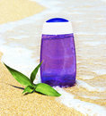 Shower product on sand in wave with green bamboo Royalty Free Stock Images