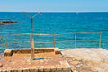 Shower on the rocky beach in Istria Royalty Free Stock Photo