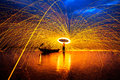 Showers of hot glowing sparks from spinning steel wool Royalty Free Stock Photography