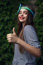 Showing thumb up happy girl model with big lips show Royalty Free Stock Photos