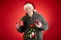 Showing toy snake happy man in santa cap in open giftbox Stock Photos