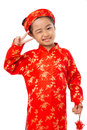 Showing two fingers cute little girl in ao dai dress winking and Stock Image