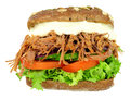 Shredded Beef Filled Pumpernickel Bread Sandwich Royalty Free Stock Photo