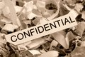 Shredded paper confidential tagged symbol photo for data destruction banking secrecy and confidentiality Stock Images