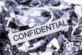 Shredded paper confidential tagged symbol photo for data destruction banking secrecy and confidentiality Royalty Free Stock Photography