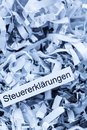 Shredded paper tax returns tagged with symbol photo for burden and retention requirements Stock Images