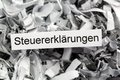 Shredded paper tax returns tagged with symbolic photo for burden and obligation to preserve Stock Image