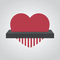 Shredding heart fed into electronic shredder Royalty Free Stock Photography