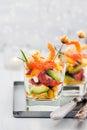 Shrimp, avocado, tomato, salmon and red caviar cocktail salad in