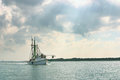 Shrimp boat returns from day of fishing a on the gulf coast in texas to port after a Royalty Free Stock Photo
