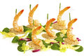 Shrimp boats with lettuce and mayonnaise as sea crisp bread shapes wooden sticks capped onion stalks hold the shrimps upright corn Royalty Free Stock Photos