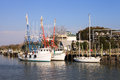 Shrimp boats at shem creek sc docked in which flows through the heart of mt pleasant near charleston south carolina this is a very Stock Image