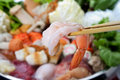 Shrimp with chopsticks Royalty Free Stock Images