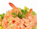 Shrimp cocktail in pink sauce with salad on white background Royalty Free Stock Image