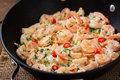 Shrimp in a creamy garlic sauce with parsley and lime frying pan Stock Photos