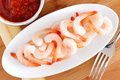 Shrimp with dipping sauce on a plate view from above on wooden table Stock Images