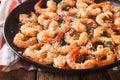 Shrimp with garlic, parmesan and herbs closeup. horizontal Royalty Free Stock Photo