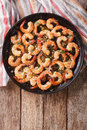 Shrimp in garlic sauce with parmesan cheese and herbs in a pan c Royalty Free Stock Photo